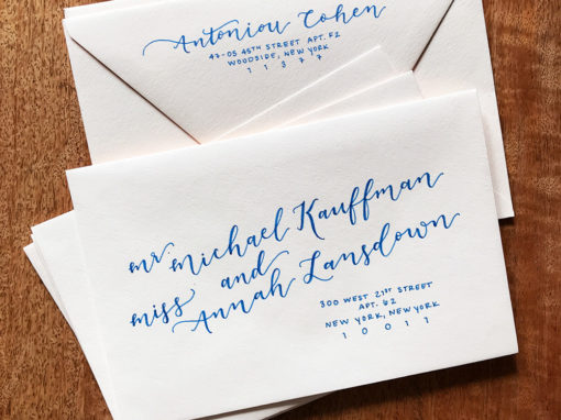 Whimsical Lettering on Blush Envelopes with Navy Ink